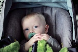 Baby in car seat with mirror